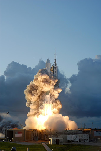 The rocket carrying NASA's Dawn spacecraft rises from the smoke and fire on the launch pad to study a pair of asteroids.