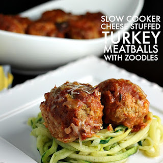 Slow Cooker Cheese Stuffed Turkey Meatballs with Zoodles.