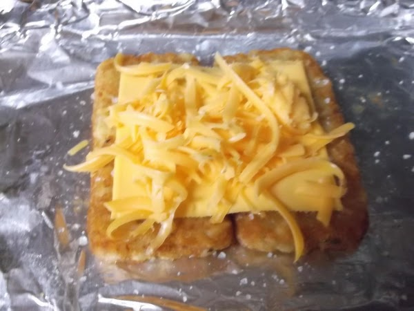 Place American cheese slice on top; sprinkle with 1/2 of the cheddar cheese; set...