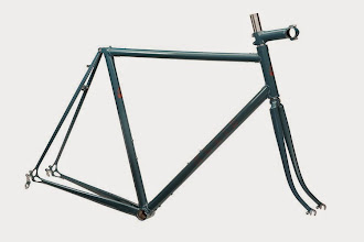 Photo: The finished frame in a cool teal with subtle copper logos.
