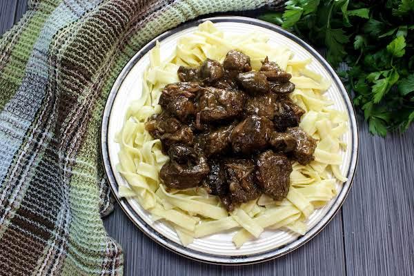 Crock Pot Beef And Mushrooms Over Egg Noodles.