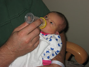 """Photo: Elizabeth is thinking: """"Dad, you do know this bottle is done, right?"""""""
