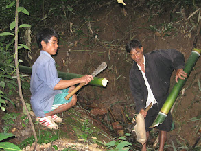 Photo: The guide and local guide prepare bamboo for carry water-3 Days Nam Ha Jungle Camp in Luang Namtha, Laos