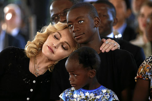 Dreaming: Madonna embraces her son, David Banda, at the opening of a hospital in Blantyre, Malawi, in July. Picture: REUTERS