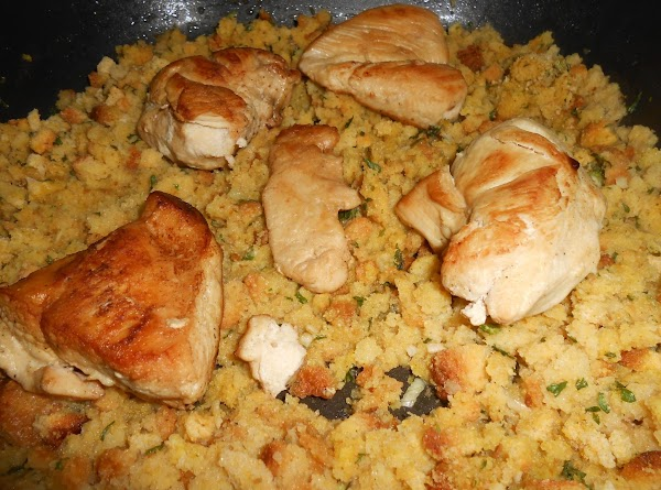 Place the chicken on the stuffing.