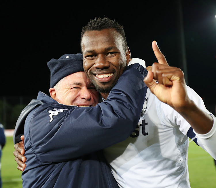 Bidvest Wits chairman Brain Joffe and defender Bongani Khumalo celebrate after winning an Absa Premiership match. Khumalo has since left the club.
