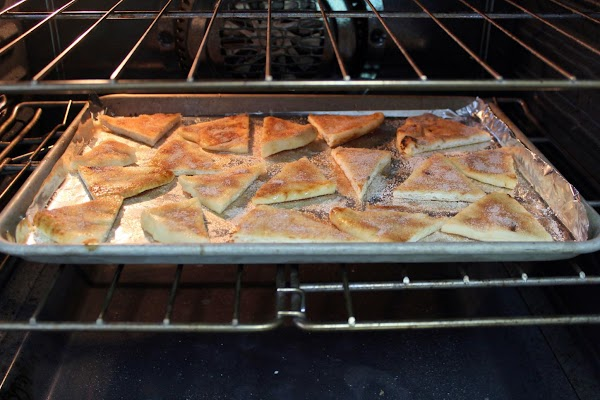 Naan bread toasting in the oven.