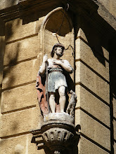 Photo: Well preserved statuary like this is seen on building corners.