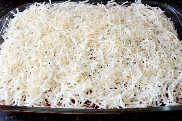 Begin to assemble your lasagna.  The layers are:  a. Pour a small amount of...
