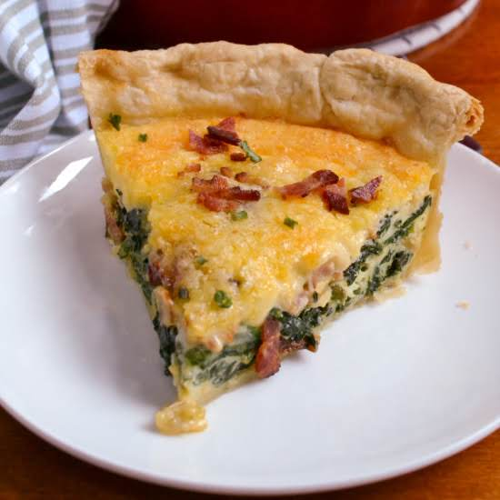 A Delectable Deep Dish Spinach Quiche Made With Sautéed Spinach, Onions, Garlic, Crisp Bacon, Swiss And Cheddar Cheese For An Over The Top Breakfast Or Brunch Treat.  Double The Recipe And Make Two.  Bake One Off Now And And Freeze One For Later.
