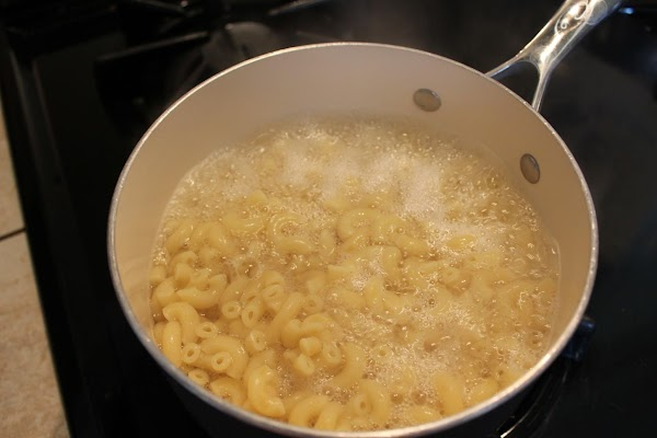 Preheat oven to 375°. Cook macaroni according to directions, drain and set aside.