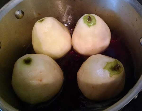 now place the pears in the pan, they will not be fully submerged, and...