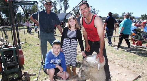 Regular supporter of the Eulah Creek Machinery Day Richard Gillham, right, with Tim Scanlon, demonstrated sheep shearing through the ages with hand shears and vintage shearing equipment. Mr Gillham and Mr Scanlon are pictured with fascinated visitors Josh and Katelyn Apps.