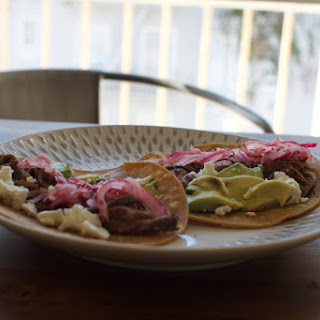 Slow Cooker Carne Asada Tacos with Pickled Onions.