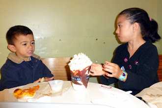 Photo: Discussing the finer nuances of their Ghirardelli chocolate sundae. One cannot visit San Francisco without having one.