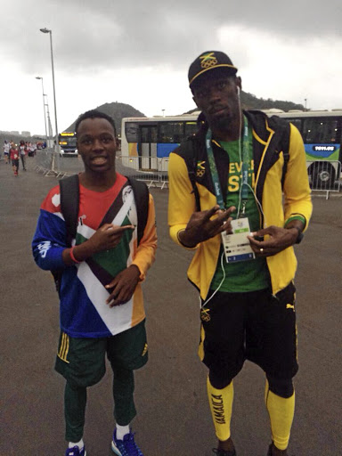 Clarence Munyai with Usain Bolt at the Athletes Village in Brazil during the 2016 Rio Olympic Games.