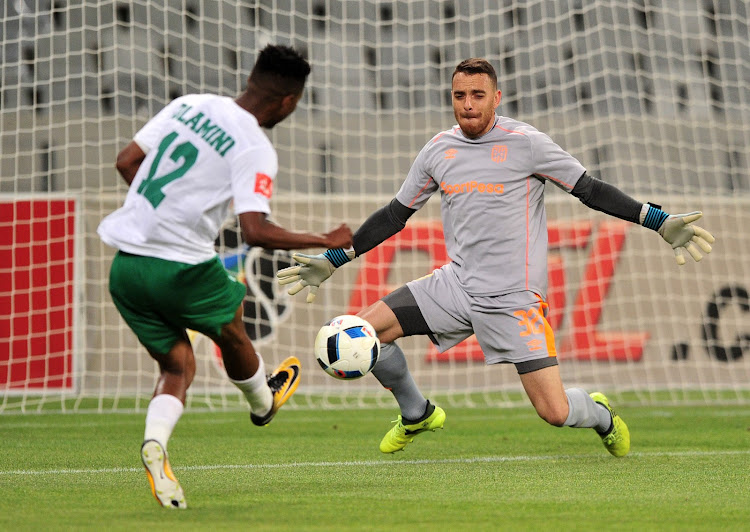 Cape Town City FC goalkeeper Sage Stephens makes a save from Sduduzo Dlamini of AmaZulu during the Absa Premiership game at Cape Town Stadium on 15 December 2017.