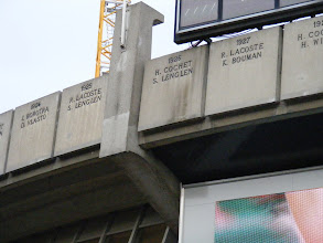 Photo: The stadium is ringed by the names of all French Open men's and women's singles winners. Here a reminder of the glory days of French tennis in the 1920's, when the Four Musketeers (Borotra, Lacoste, Cochet, and Brugnon) dominated the men's game, while Susanne Lenglen (for whom one of the stadia is named) was a major force in the women's game.