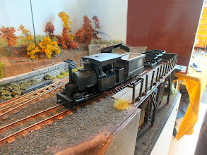 Photo: 019 A quaint little Porter tank loco prepares to pick up empty skips from the narrow-to-standard gauge loading chutes .