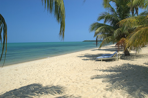 Belize-beachfront.jpg - Sparkling sand on the coast of Belize.