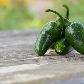 Heat on the table by Benjamin Howen III - Food & Drink Fruits & Vegetables ( wood, pepper, table, jalapeño, vegtable )