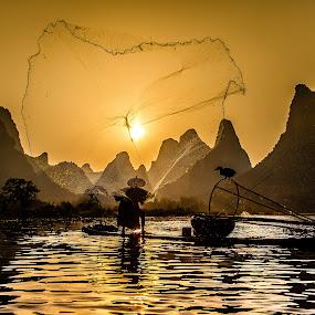 Casting a Net by David Long - People Professional People ( li river, cormorant fisherman, guilin )