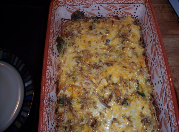 Remove casserole from oven and top with remaining cheese blend (my combo was colby...