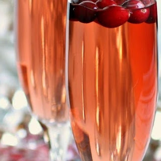 Sparkling Apple and Cranberry Champagne Cocktail.