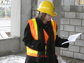 Photo: Joan Cook examines the plans for her new office.