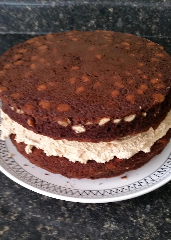 Place first cake on a plate. Lightly frost the top of cake layer with...