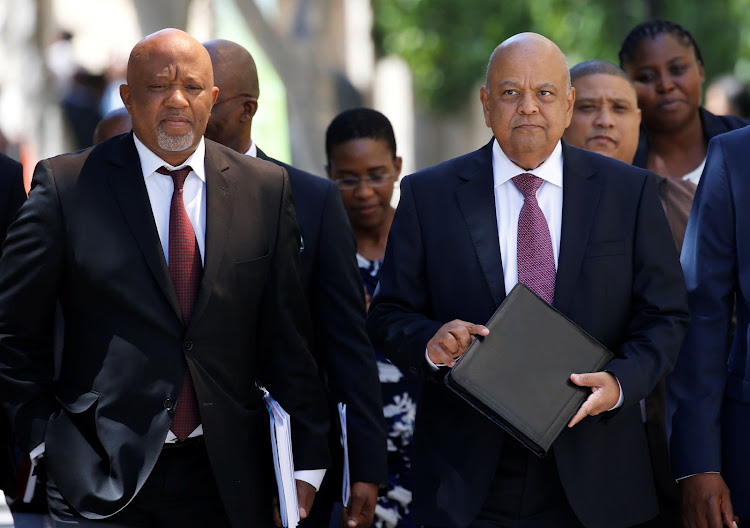 Former Finance Minister Pravin Gordhan, right, and former Deputy Finance Minister Mcebisi Jonas. Picture: REUTERS/MIKE HUTCHINGS