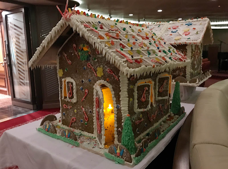 A gingerbread house lit up in the Panorama Lounge on Silver Spirit during the holidays.