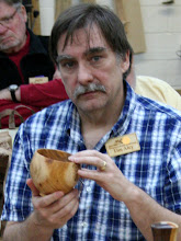 Photo: Tim show his small bowl made from the Florida exchanged Cuban Mahogany.