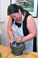 Photo: Jean pounding the galanga with garlic and shallots