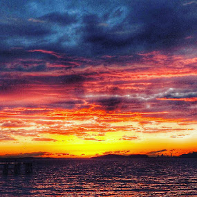 Sunset at the bay  by Ann Goldman - Landscapes Sunsets & Sunrises ( clouds, water, sunset, cloudscape, spring )