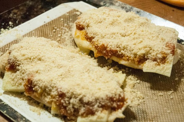 Add a generous layer of the Parmesan cheese mixture to the top.