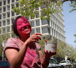 Photo: Requirement 3 (outdoor available light): The subject, after the Holi Festival of Colors, sits along University Ave, enjoying her froyo. Her face is covered in bright pink powder and is mostly illuminated by the natural sunlight from above. The other side of her face is in slight shadow, shaded by the tree above. No additional fill lights. I like the shocking pink color and even more, how the bright pink stands out when highlighted by the sun. Post-processing: cropped.