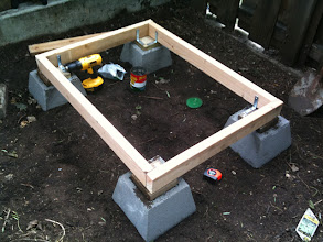 Photo: I began with building a raised foundation for the coop. The framework you see will also accommodate a pull-out mucking drawer.