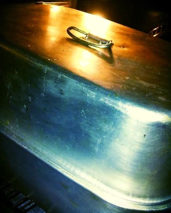 Put lid on large roaster pan, put in oven.