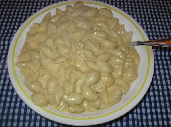 Drain pasta and add to cheese sauce.Mix gently. Taste to see if you need...