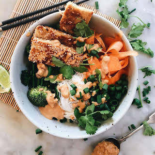 RICE NOODLE BOWLS WITH THAI PEANUT SAUCE AND SESAME TOFU SCHNITZEL STRIPS.