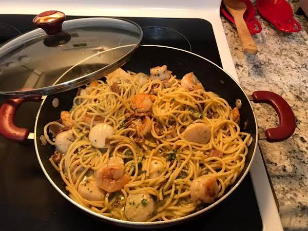 Seafood Carbonara Prepared With Sea Scallops And Shrimp And Bucatini.
