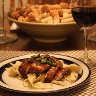 Portobello Steaks over Garlic Chive Papperdelle Pasta.