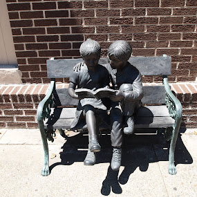Tell Me A Story by Jackie Sleter - City,  Street & Park  Markets & Shops ( reading, statue, park, children, outside )