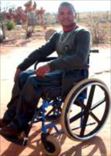 PARALYSED: Charles Masombuka from Marapyane in Mpumalanga was involved in near-fatal accident two years ago. Pic. Alfred Moselakgomo. 25/07/07. © Sowetan.
