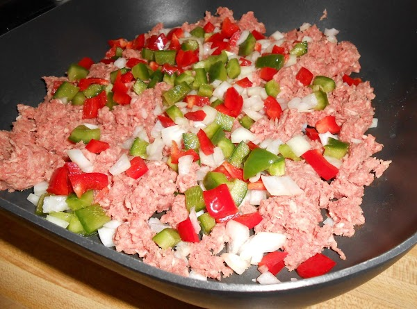 In large skillet, brown the ground chuck with the onion and green pepper; drain....