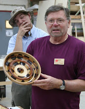 Photo: Richard Webster with a segmented bowl made from two checkerboards...