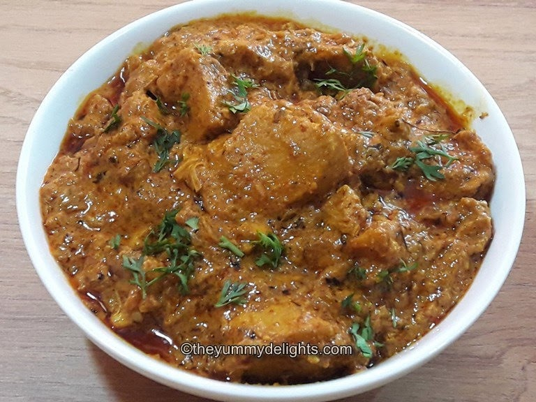 dahi chicken curry served in a white bowl