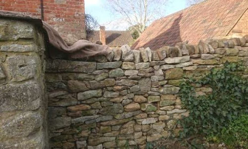 The other side of this apparent dry stone wall is a limestone wall backed with NHL