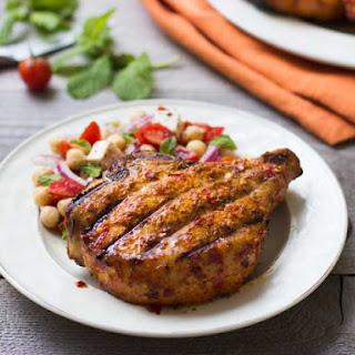 Piri-Piri Pork Chops with Chickpea and Tomato Salad.